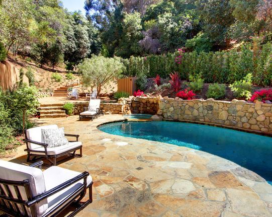 landscaped hill & pool
