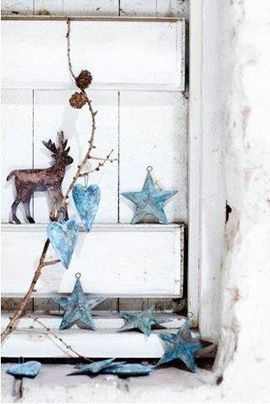 Woodland Christmas   reindeer, branch with pine cones and tin stars and hearts   simple rustic Christmas decor