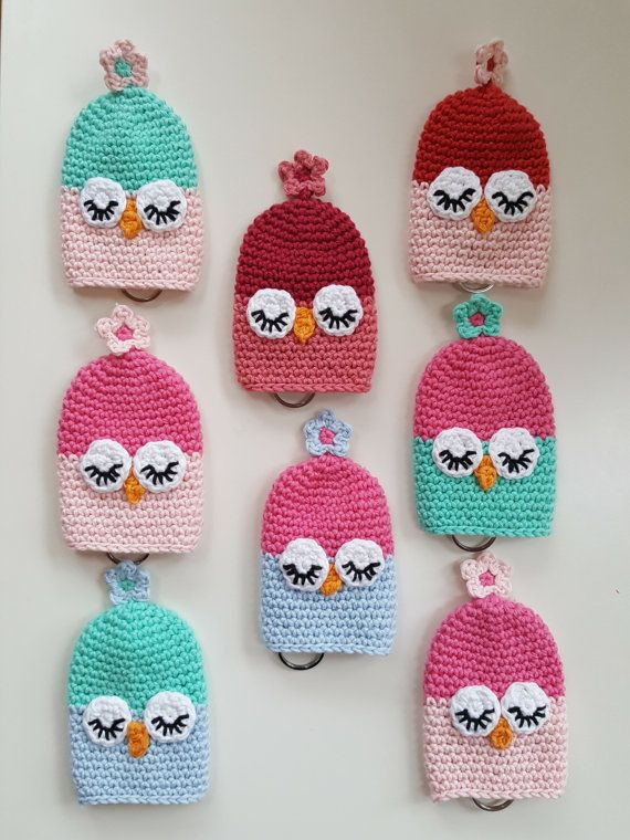 This listing is for one cute little owl keycosy, made in cotton yarn. These cosies keep all of your keys snug and tidy (I have 10 keys tucked into my own one!) . Keys are attached to the enclosed keyring. Then you pull the flower string at the top and the keys disappear inside the cosy. This really helps stop the keys from tearing the lining of your handbag!  These little owl keycosies are available in a variety of colours. Please select which one you would like from the drop down box at the…