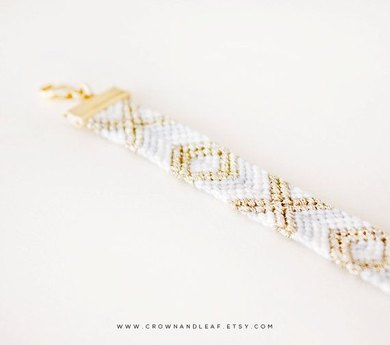 A modern take on the classic friendship bracelet. This bracelet is perfect for wearing alone or stacked with more.  Colours: Light grey, white and gold.  All bracelets are handmade by myself, meaning that each one is unique. This bracelet features an adjustable chain which will fit anyone with a 5 to 8 inch wrist size, however if you would like it either shorter or longer then please message me before ordering.  -  Thanks for visiting my shop, hopefully you found the perfect gift or little…