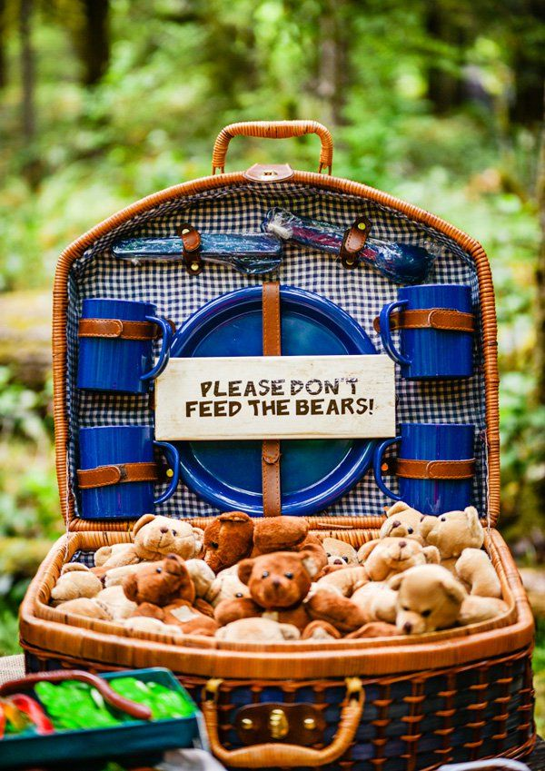 Party in the woods! This boys camping birthday party has s'more cupcakes, homemade granola, campfire flame snacks, a scavenger hunt & bear lollipops!
