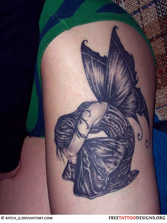 Sad fairy tattoo on a girl's leg