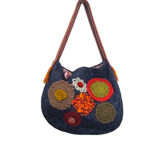 Cotton outside fabric with sateen lining.  Crotchet motifs. Bag made by the pinner, Jenny,  from Hook and Bobbin Bags.