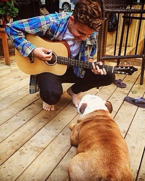 I WISH HE WAS SERENADING ME AS WELL AS THE DOG BUT I LOVE HIS FEET AND HIS CLOTHING AND HIS HAIR AN NO I DO NOT HAVE A FOOT FETISH