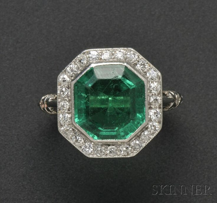 Art Deco Platinum, Emerald, and Diamond Ring, T.B. Starr, bezel-set with an emerald-cut emerald measuring approx. 9.70 x 9.20 x 4.80 mm, framed by old European-cut diamonds, elaborate heart-shape gallery and shoulders