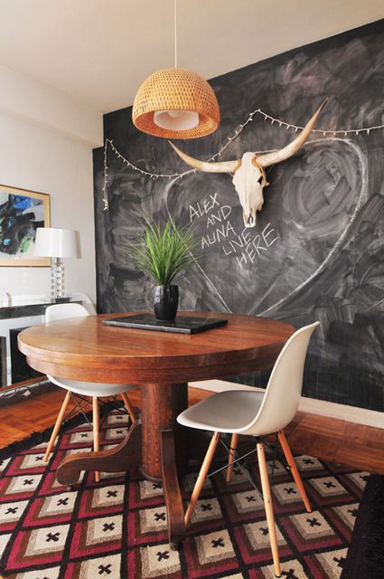 love the pendant light and table and chairs and rug and even the chalkboard wall doesn't seem so cliched here