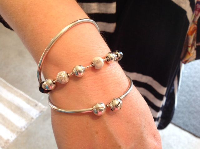 Pandora Bangles layered with Pandora's Essence Collection!