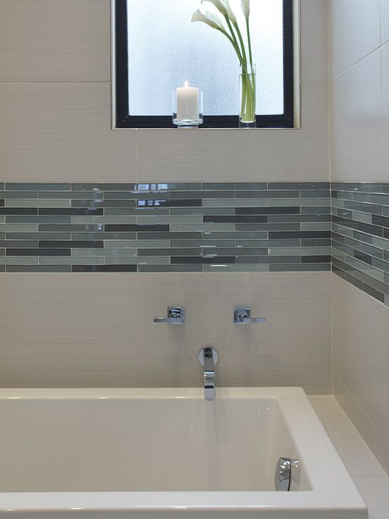 Downstairs bathroom: white subway tile in shower stall with glass mosaic inserts