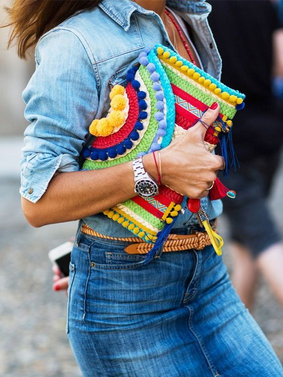 This multi color clutch makes the outfit pop