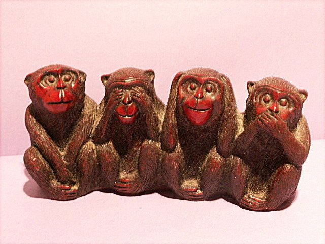 Monkeys look wooden.  Sold in GIFTS/MINIATURES - SMALL ITEMS.
