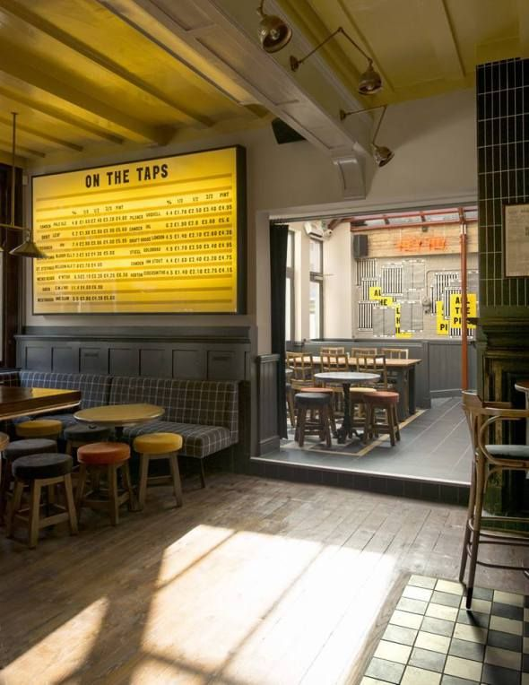 draft house hammersmith, relic interiors, victorian floor tiling, industrial chandeliers, tramshed, neons, traditional pub, london pub, stained glass windows, living wall, industrial interior, black yellow red, beer cage, beer garden, chequerboard floor, palais de danse, cinema light box