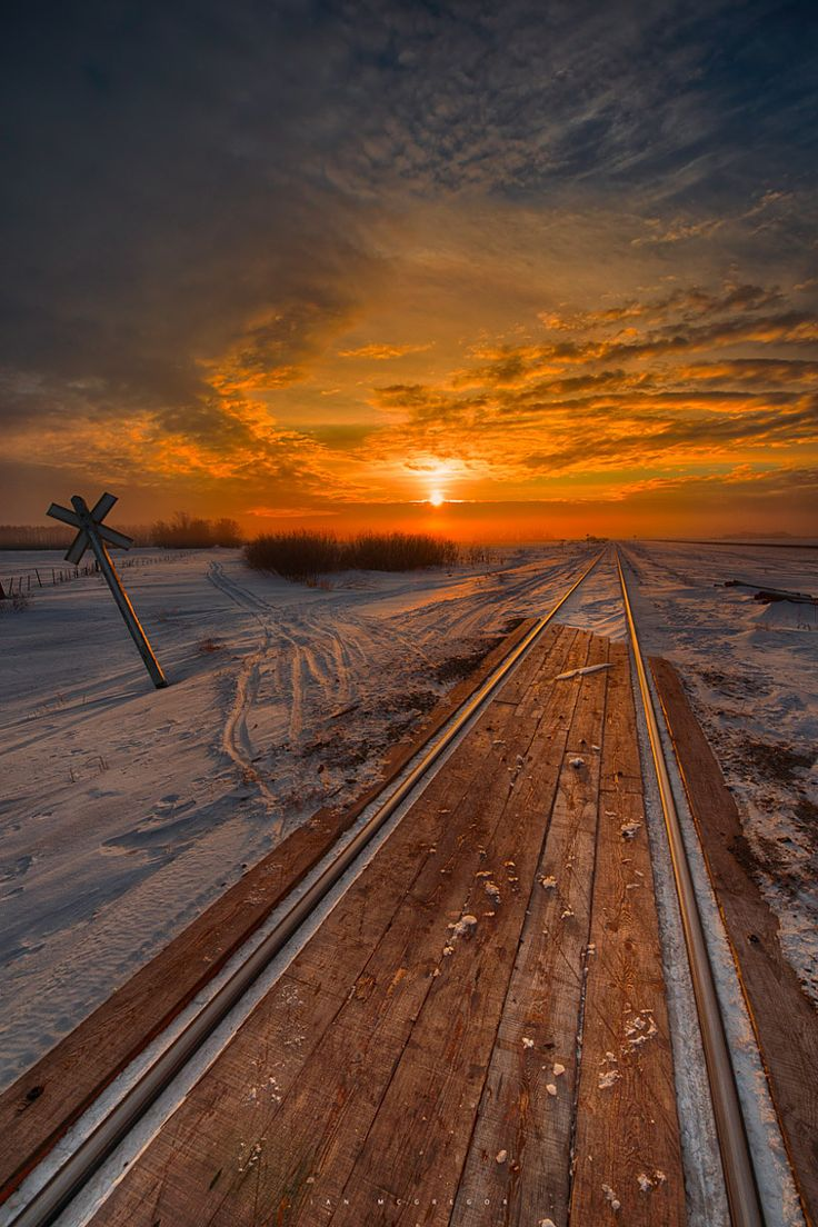~~Crossing Dawn   the morning sun peaks over a layer of cloud and illuminates this small rail crossing, Yorkton, Saskatchewan, Canada   by Ian McGregor~~