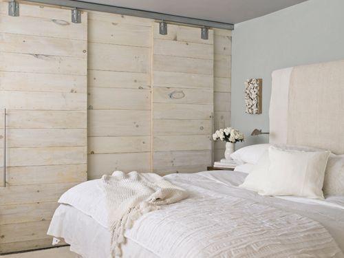 Bobby Houston's Cabin Decor - Modern Cabin Decorating Ideas - Country Living. sliding barn doors; neutral bed linens