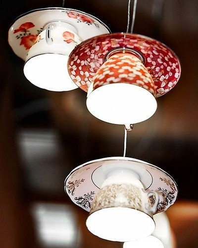 lighting made from tea cups and saucer. I have no idea where I would do this but the thrift shops have tons of these.hmmm...thinking.