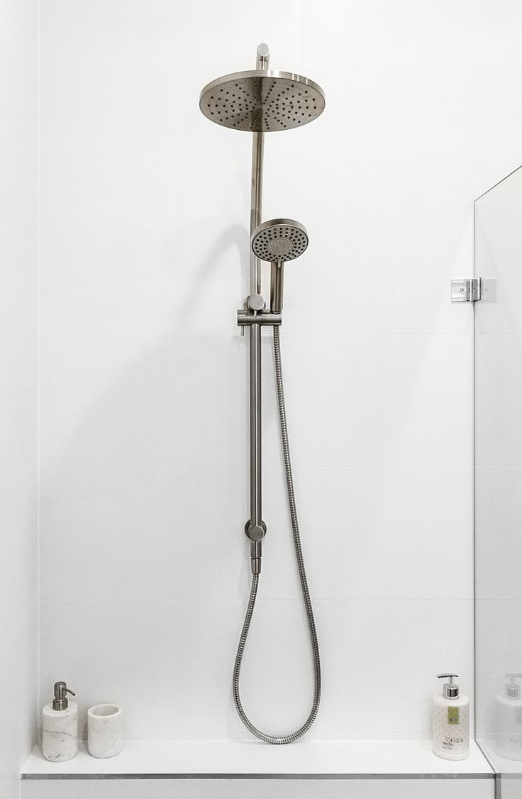 Brushed nickel shower combo.