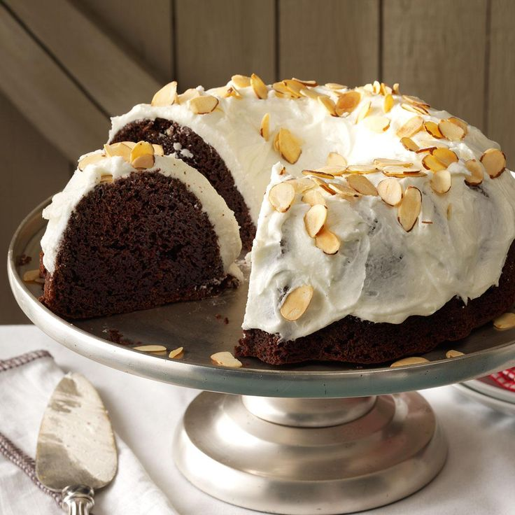 Chocolate Almond Cake Recipe -Fluffy white homemade frosting tops this rich chocolate almond cake. Sliced toasted almonds on top add a little crunch. —Sherri Gentry, Dallas, Oregon