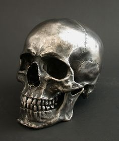 Skull sculpted in Stainless Steel, oil blackened and highlighted finish.