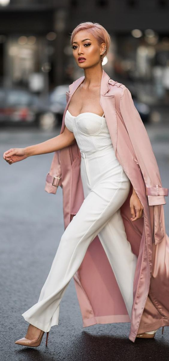 Tap into refined, elegant style with a dusty pink lightweight trench and white wide leg pants. This outfit is complemented perfectly with cream leather pumps.   Shop this look on Lookastic: https://lookastic.com/women/looks/pink-trenchcoat-white-bustier-top-white-wide-leg-pants/23366   — White Bustier Top  — Pink Lightweight Trenchcoat  — White Wide Leg Pants  — Beige Leather Pumps