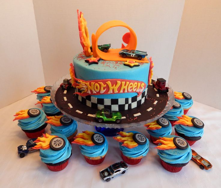 Austin's Hot Wheels cake and cupcakes! 8 inch cake and 2 dozen cupcakes! All candy clay and buttercream, all edible except for the cars which were for the birthday boy to keep! (Cars in these pics were borrowed from my hubby, just for picture taking purposes! lol) https://www.facebook.com/angelas.cakes2011