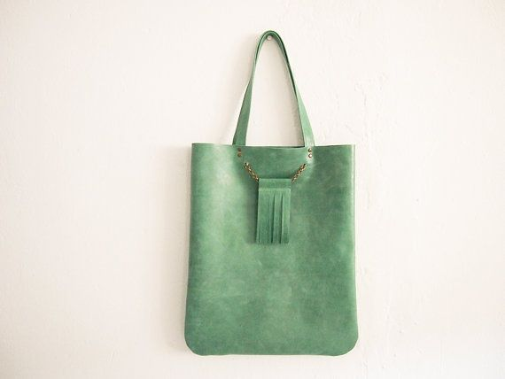 Green mint tote leather bag with tessel detail hanging by monatao, $85.00