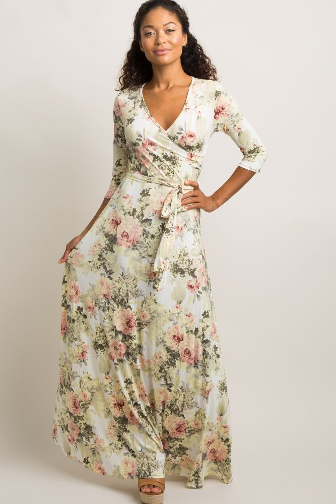 3ca36af85ce Ivory Floral Wrap Maxi Dress A floral printed wrap maxi dress. V-neckline.  Sash tie at waist. 3 4 sleeves. This style was created to be worn before