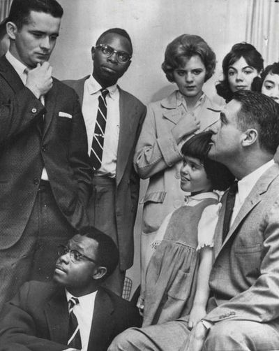 Sargent Shriver (right) speaking to a group of Peace Corps volunteers at his home in Chicago, 1961. That's a 5 year old Maria Shriver on his lap… Shriver moved to Chicago to manage the Merchandise Mart (owned by the Kennedy family for more than 50 years). It was while here that JFK tapped him to launch the Peace Corps.