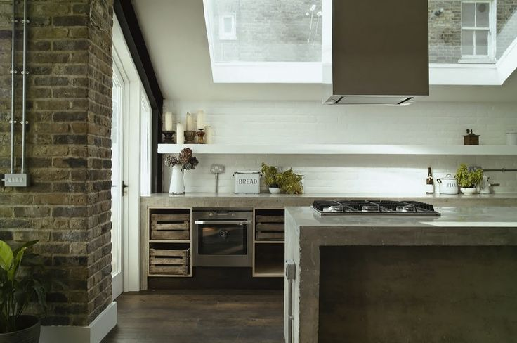 """love the rustic crates in the concrete """"shelves"""", brick wall, clean white shelf above counter, concrete""""counter"""", natural light, wide plank wood floors.     greige: interior design ideas and inspiration for the transitional home by christina fluegge"""
