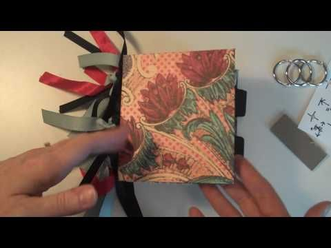tutorial - make your own binder - she uses 3 loose binder rings which are held tight by the ribbons on the outside. The inside has a very finished look.