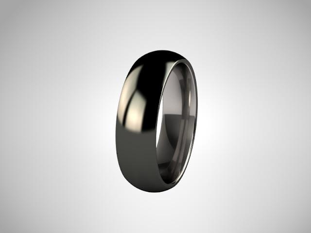 Siyah Elmas Kaplama Titanyum Yüzük: Cool Ring, I don't know what the rest says!