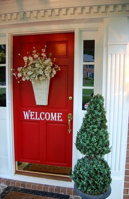 love everything about this door...love the basket of flowers...and one of these days I'll get around to painting my door...and the welcome is such a nice touch!