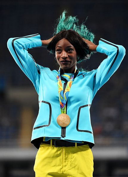 Gold medalist Shaunae Miller of the Bahamas reacts during the medal ceremony for…