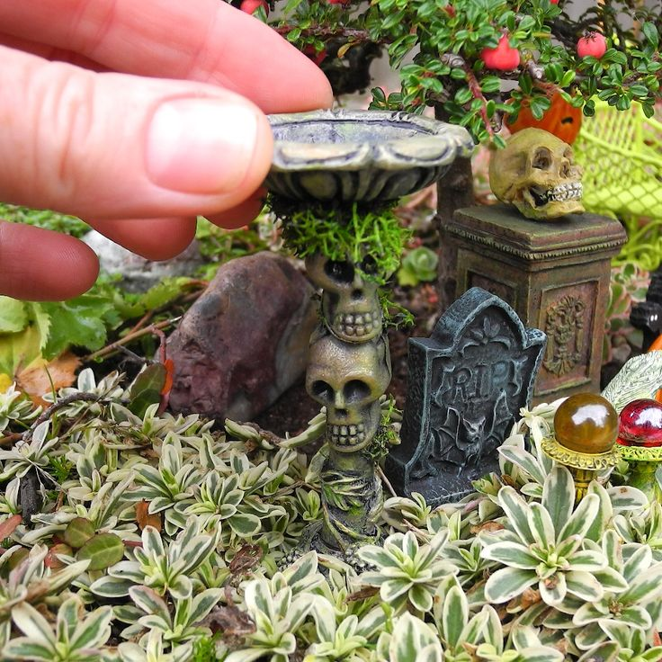 decorating fun in the miniature halloween garden