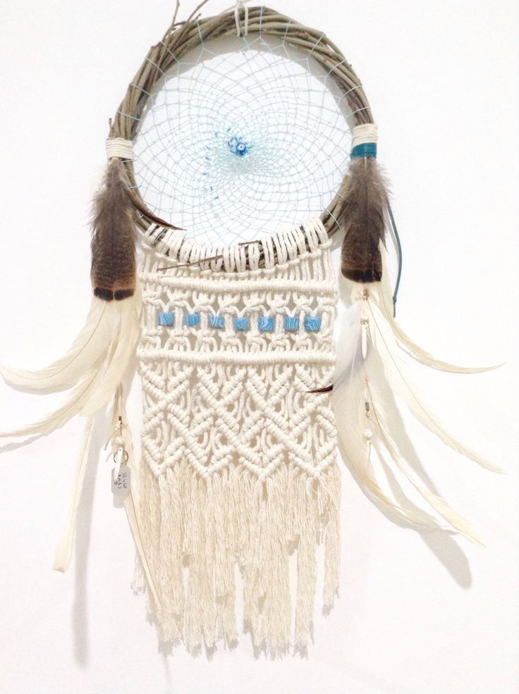 A personal favourite from my Etsy shop https://www.etsy.com/au/listing/491568027/dreamcatcher-macrame-feathers