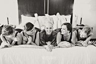 bride with her brides maids morning of the wedding picture. so adorable.