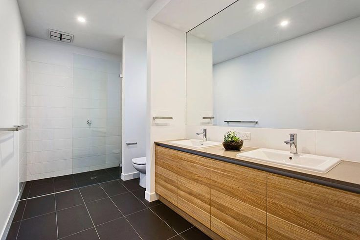 Large modern bathroom with feature vanity and double shower.
