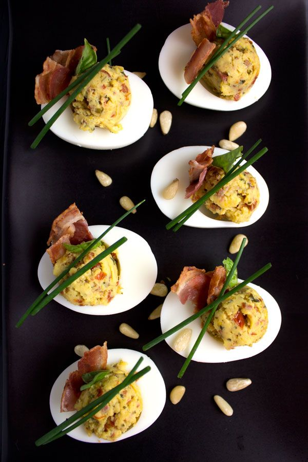 These Italian style deviled eggs are a delectable twist on the classic. Plus! The one small tweak to make peeling those eggs Oh So Easy!