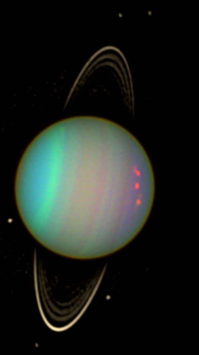 Researchers may have spotted two small dark moons hidden in rings of Uranus