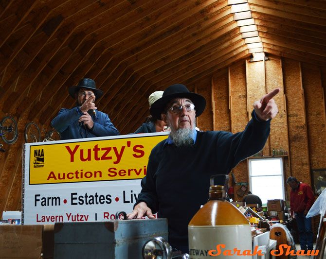 Bidders are recognized with a point at an Amish Farm Auction   via WanderShopper