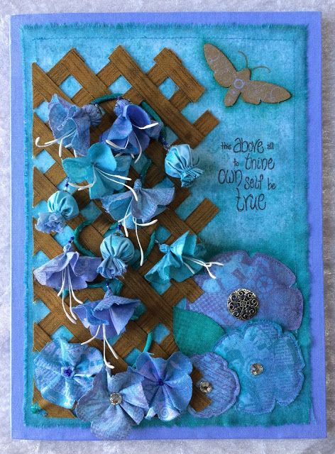 A fabric card using Distress Inks and Paper Artsy flower stamps.