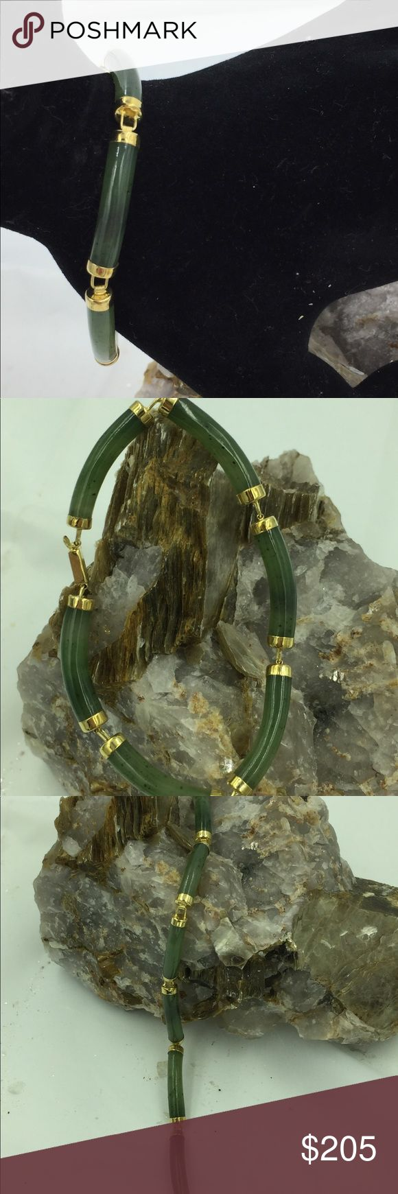 "14K Gold Jade w/ Impurities Tubular Bracelet 6.75"" Up for sale is a beautiful green Jade with impurities tubular bracelet set in 14K solid yellow gold. There is a Chinese character on the clasp. The ends of each bar has a solid gold cap for protection & stability. The impurities in each tubular jade add character & drama to this stunning piece.  Stamped: 14K GSJ Size: 6.75"" long x .20"" x .19"" thick Weight: 9.7g Jewelry Bracelets"