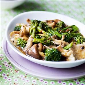 Winter broccoli and mixed mushrooms in garlic black bean sauce recipe. Ching-He Huang's delicious vegetarian stir-fry is a quick and easy winter dish.