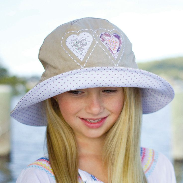 Applique bucket hat made from linen with soft applique motif.  Colours: owl/green polka dot & hearts/lilac polka dots. Sizes: 52cm and 55cm to fit 2-8 years approximately.  RRP: $34.00  Shop: https://rigon-headwear.myshopify.com/collections/kids/products/b80-applique-bucket-hat