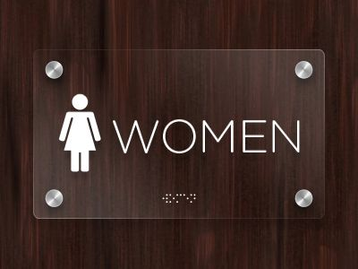 Woman (restroom signage) by Kevin R. Johnson