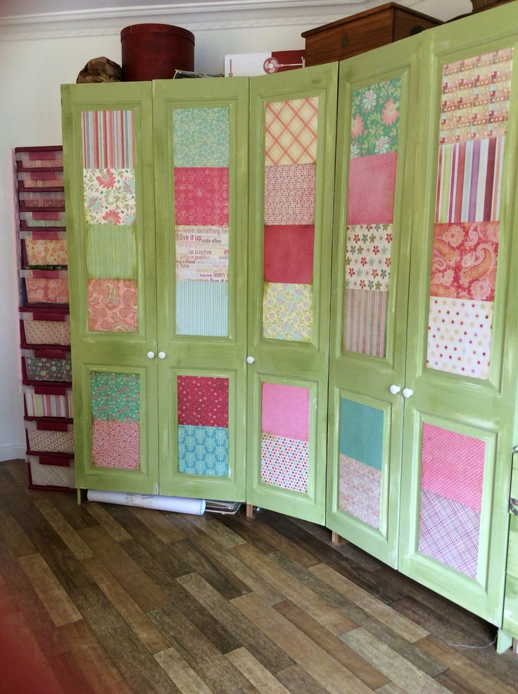 Repainted the craft cupboards than added scrapbook paper to the front I like the look.