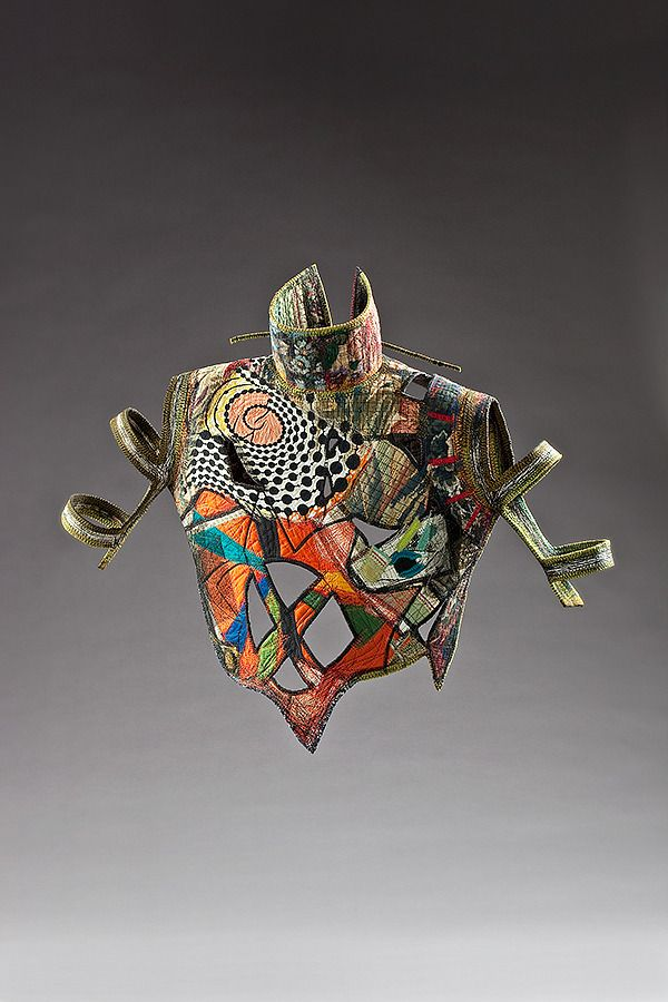 """Kay Khan - 23"""" x 27"""" x 9""""; silk and cotton; deconstructed turtleneck: """"armored"""" with imagery and stitching"""