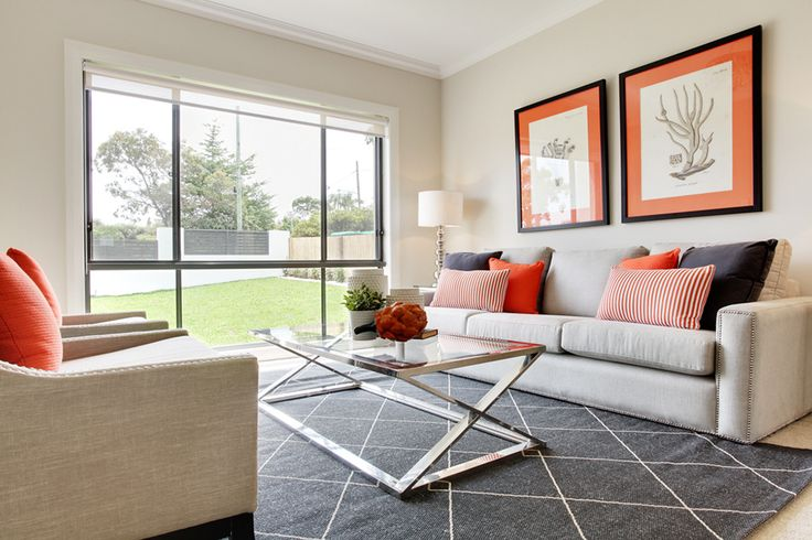 Contrast of orange and charcoal create a sophisticated formal lounge room