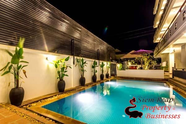 Boutique hotel with swimming pool and lush tropical garden for sale. In the heart of Siem Reap and about 5 minutes walk to the city center. 30 well furnished rooms, decorated in a simple and natural style. There is a restaurant located on 4th floor with beautiful views serving traditional Cambodian and international cuisine. Nicely landscaped swimming pool set up with sun beds for relaxation plus an outdoor bar which provide local and international drinks. Sale price is $1,300,000.