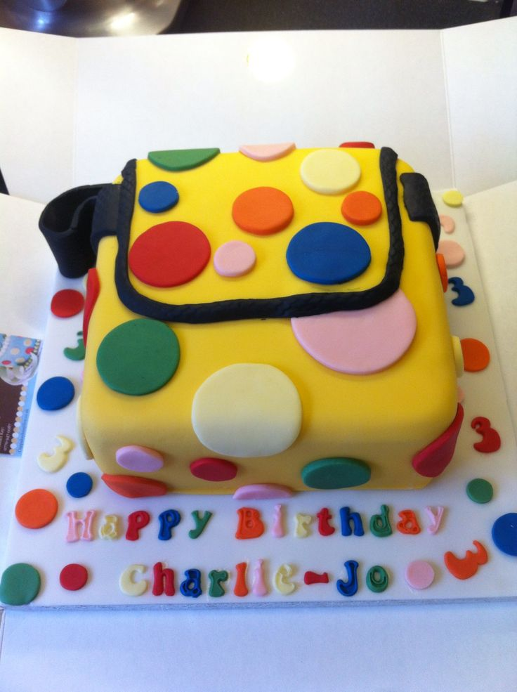 Mr Tumble's Spotty bag cake with cookies and cream flavour sponge and filling