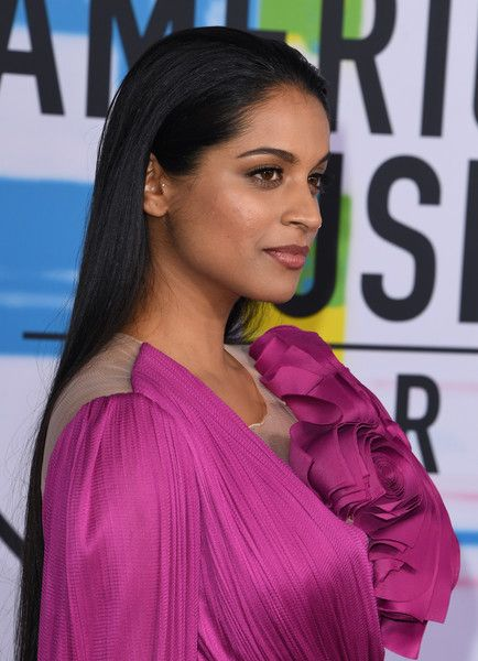 Lilly Singh Photos - Indian-Canadian YouTube personality Lilly Singh arrives at the 2017 American Music Awards on November 19, 2017, in Los Angeles, California. / AFP PHOTO / Mark Ralston - 2017 American Music Awards - Arrivals