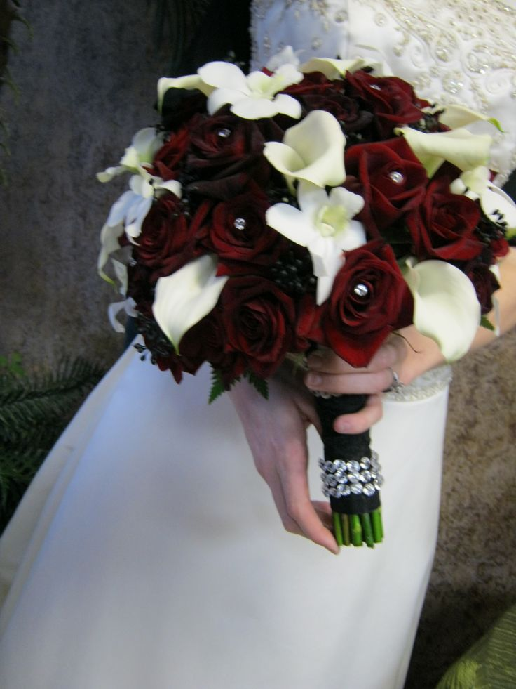 Hand tied bridal bouquet with mini calla and black magic roses with an accent of black